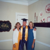 Nick with his mother and his aunt on his high school graduation in 2001.